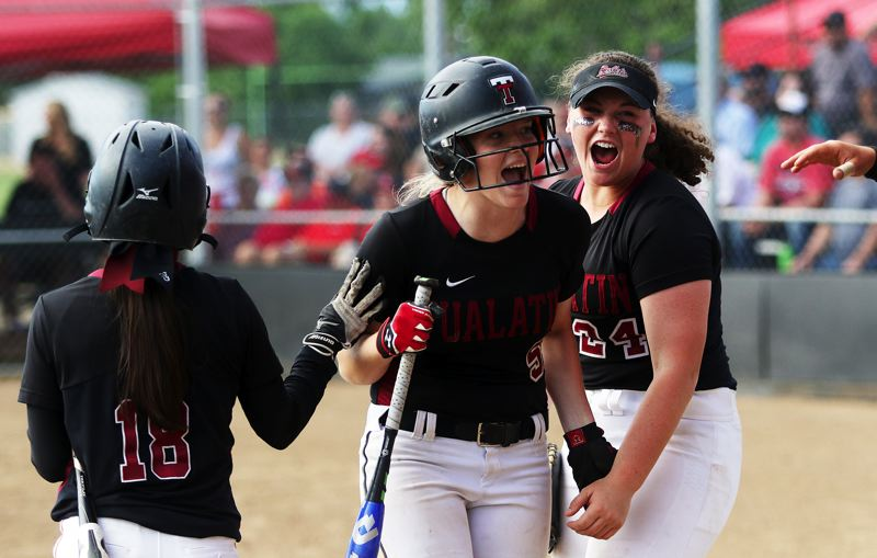 DAN BROOD - Tualatin senior Sammi Caron (center) celebrates with sophomore Andrea Gomez (left) and sophomore Emily Johansen after scoring a third-inning run in the state playoff semifinal game at North Medford.