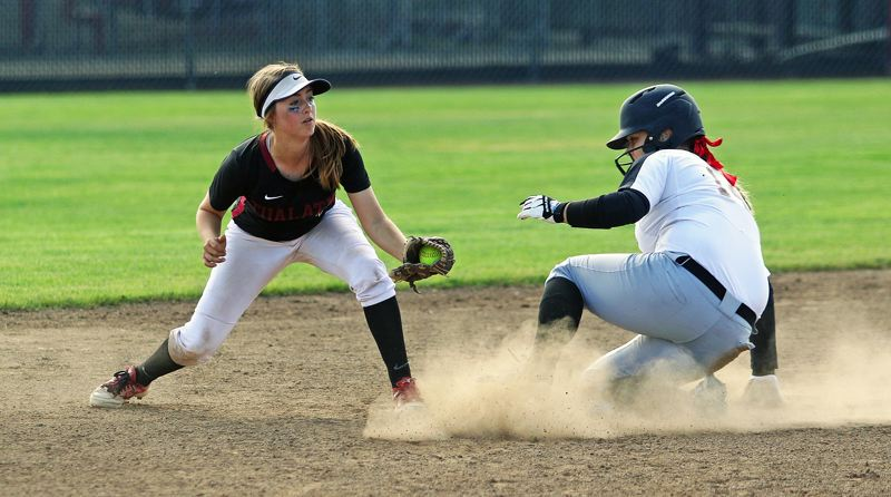 DAN BROOD - Tualatin freshman shortstop Bella Valdes (left) looks to put a tag on North Medford's Danyelle Milam, who doubled in the fourth inning.