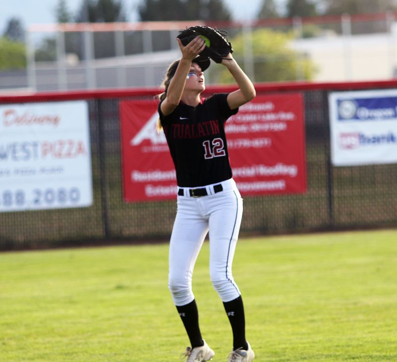 DAN BROOD - Tualatin junior left fielder Ella Hillier catches a fly ball during Tuesday's state semifinal game.