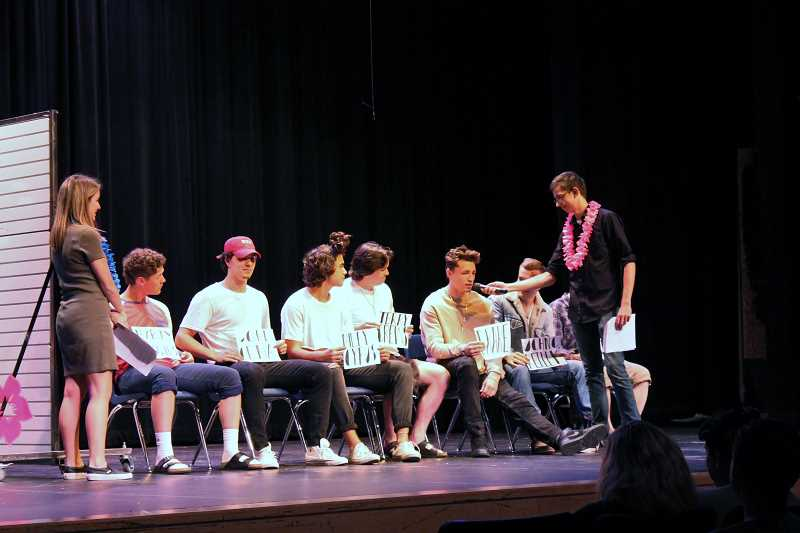 SPOKESMAN PHOTO: ANDREW KILSTROM - Mr. Wildcat contestants take part in a blind dating game skit. The even raised nearly $2,000 for Doernbecher Childrens Hospital Wednesday, May 31.