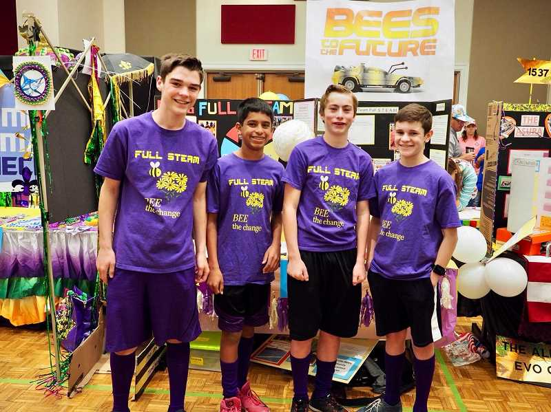 SUBMITTED PHOTO - From left, Caden Keyston, Sarthak Kadam, Camden Miller and Kullen Whittaker take a picture at the Razorback Invitational in April.