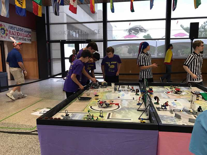 SUBMITTED PHOTO - Full STEAM gets their robot ready to go before competition at the Razorback Invitational.