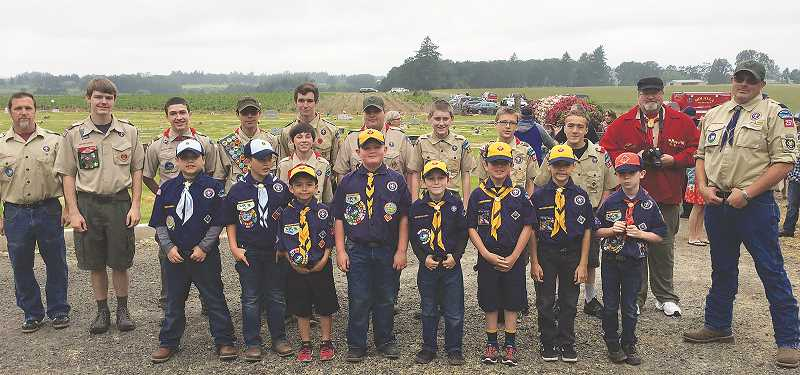 SUSAN WILLIAMS - Molalla Boy Scout Troop 257 and Cub Scout Pack 257 were the honor guard at the annual VFW Memorial Day ceremony held at Adams Cemetery by Molalla VFW Post 3973.