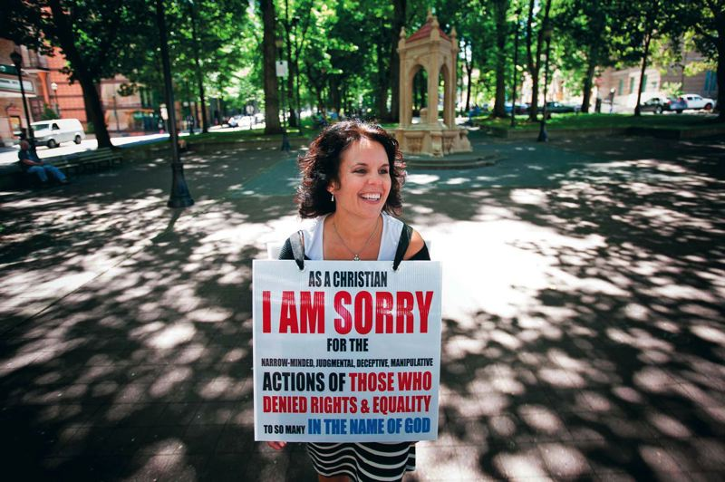 TRIBUNE PHOTO: J CHRIS ONSTOTT - Amy Piatt wore a very political homemade sign when she arrived in Portland five years ago. Yet Piatt still wont talk about individual candidates from the pulpit.