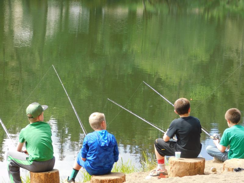 ESTACADA NEWS PHOTO: EMILY LINDSTRAND - Students at Clackamas River Elementary enjoy their time along the pond at the Timberlake Job Corps campus, waiting for the fish to bite.