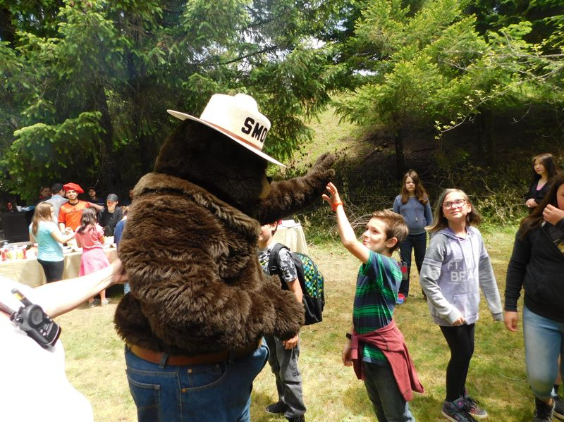 ESTACADA NEWS PHOTO: EMILY LINDSTRAND - Clackamas River Elementary School students are all smiles as they get to meet - and even high five - Smokey Bear. Smokey visited with students as a part of an event on the Timberlake Job Corps campus last week.