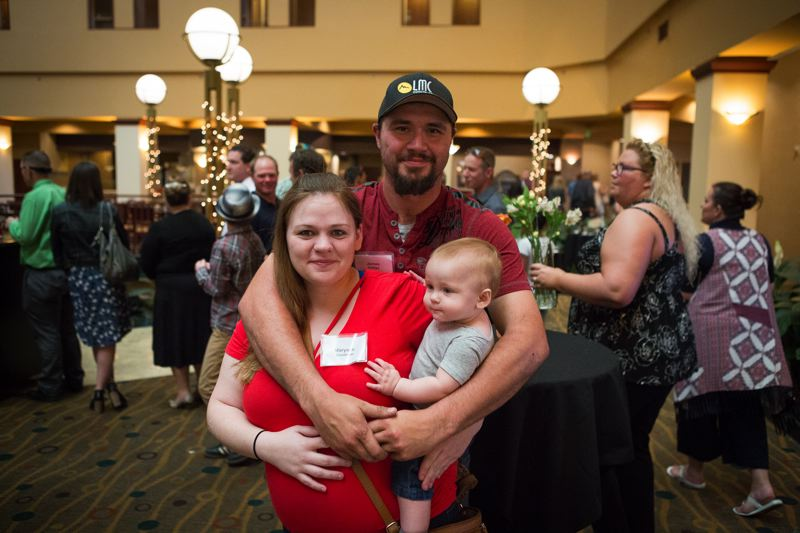 PAMPLIN MEDIA GROUP: ADAM WICKHAM  - James Phillips, his wife Maryann and son Noah, at Jamess graduation ceremony.  While working for Gregory Pacific, Phillips has done mainly footings and pipe laying. He expects his basic wage to go from $16 an hour to $20.66, the BOLI mandated minimum for qualified laborers.