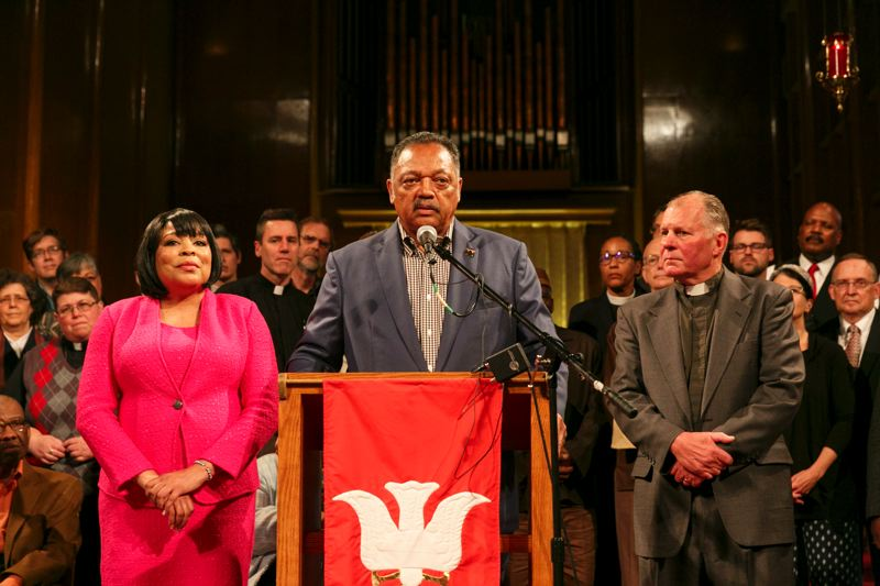 PAMPLIN MEDIA GROUP: JOHN RUDOFF - The Rev. Jesse Jackson, flanked by Multnomah County Commissioner Loretta Smith and Pastor Mark Knutson of Augustana Lutheran Church, address progressive clergy after the slaying of two men on a MAX train. He attended a prayer breakfast at Augustana followed by a brief news conference.