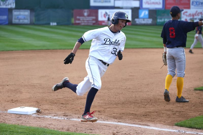 TRIBUNE PHOTO: JONATHAN HOUSE - Berry Hunt of the Portland Pickles rounds third base to score one of his three runs in Tuesday's 13-4 victory over the Marysville Gold Sox.