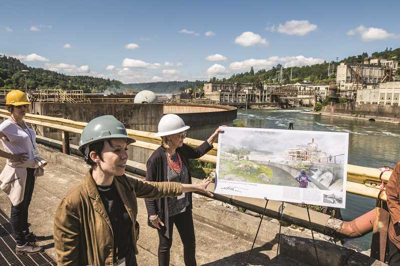 PAMPLIN MEDIA PHOTO: JON HOUSE - Snøhetta architecture firm partner Michelle Delk, second from left, details plans for the Riverwalk during a May 31 media tour.