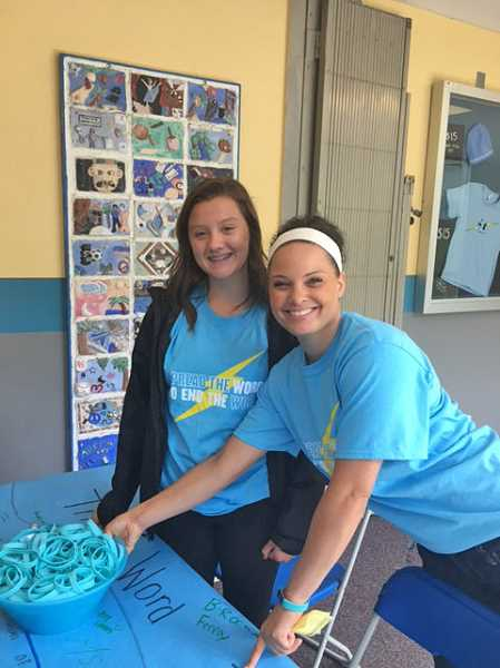 SUBMITTED PHOTO: COURTESY OF LAKERIDGE JUNIOR HIGH - Lakeridge Junior High teacher Kelsey Bowers poses with seventh-grader Kaitlyn Weidlich, a student organizer for the Spread the Word to End the Word event at the school.