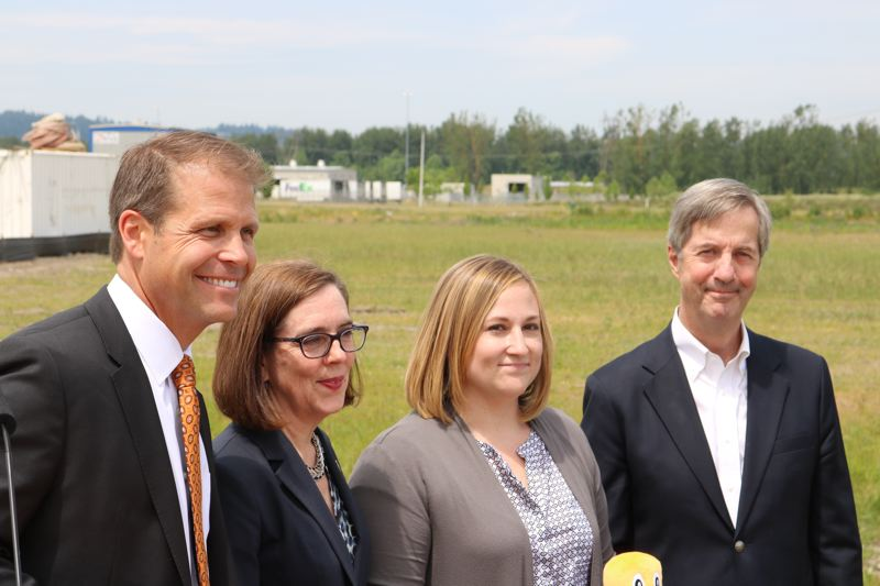 OUTLOOK PHOTO: ZANE SPARLING - FROM LEFT: Troutdale Mayor Casey Ryan, Governor Kate Brown, Amazon Regional Director Melissa Nick and Port of Portland Director Bill Wyatt face the crowd during a press conference at the Troutdale Reynolds Industrial Park on Thursday, June 7.
