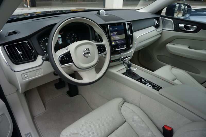 PORTLAND TRIBUNE: JEFF ZURSCHMEIDE - Inside, Volvo has really stepped up the luxury. All models come with heated leather upholstery and a nine-inch touch screen interface that responds to tablet-style gestures, just for starters.