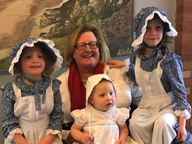 PHOTO SUBMITTED BY JODY STAHANCYK - 2017 Crooked River Roundup Grand Marshal Jody Stahancyk is eager to promote the Roundup and encourage people to visit the small-town attraction. In the photo to the left, Stahancyk poses with her three granddaughters dressed in plains attire. Pictured with Stahancyk left to right are Reagan Lee, Landon and Chloe Crawford, of Prineville.
