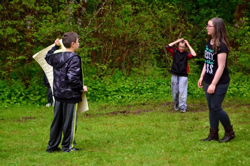 POST PHOTO: BRITTANY ALLEN - Tyton Rocha and some of his Welches Elementary classmates rehearse their zombie apocalypse film.