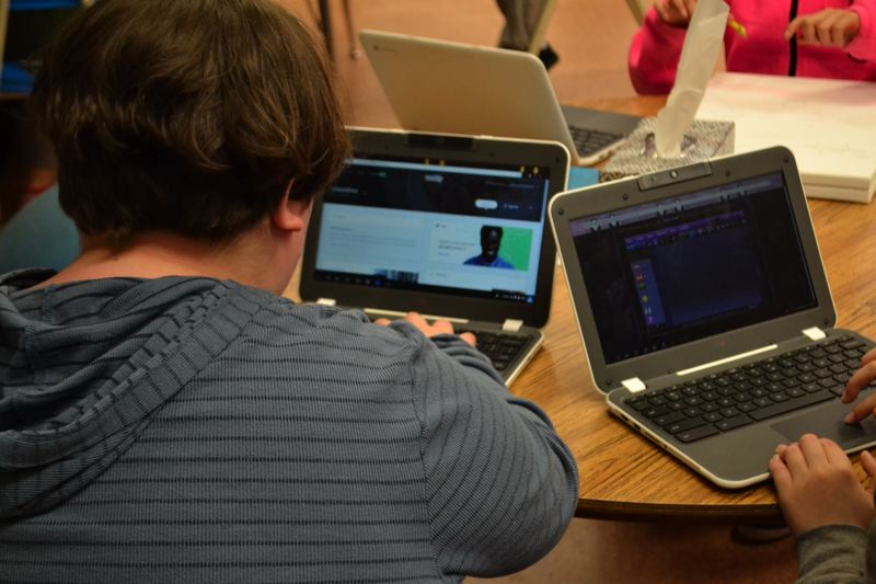 POST PHOTO: BRITTANY ALLEN - Two students work on website design.