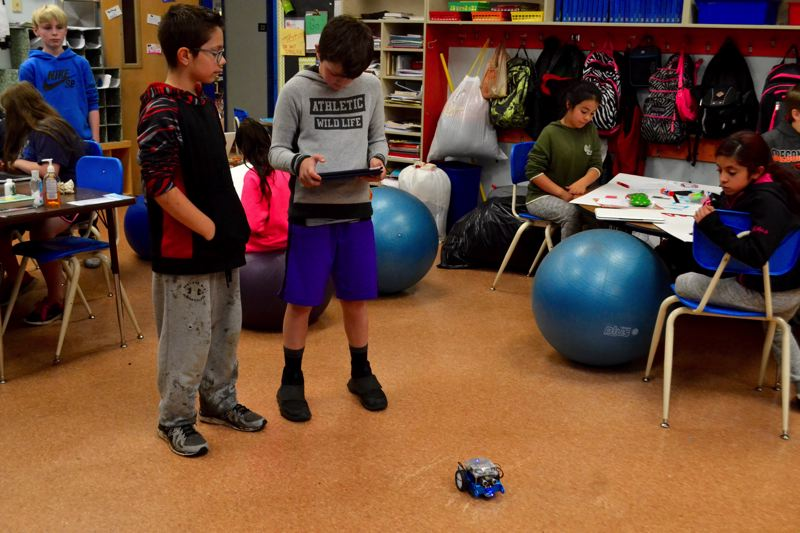 POST PHOTO: BRITTANY ALLEN - Jeb Payne shows classmates his new robot.