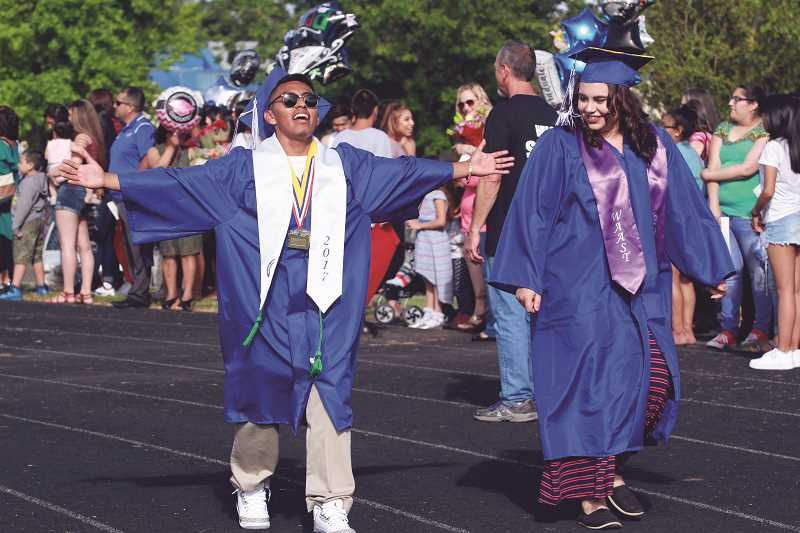 LINDSAY KEEFER - Members of the state champion soccer team donned their trophies for graduation.