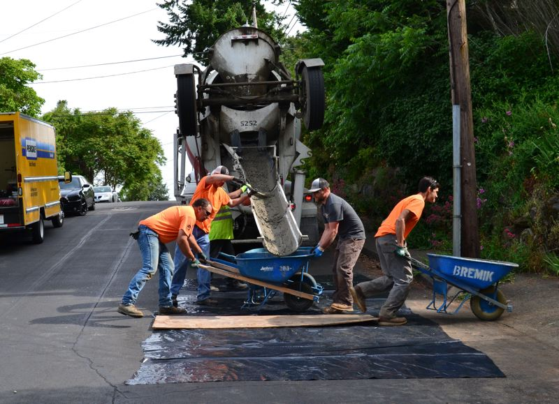 PAMPLIN MEDIA GROUP: JULES ROGERS - The 10 yards of concrete used for the sidewalk weighs 41,000 total — each man moved 12-13,000 pounds individually.