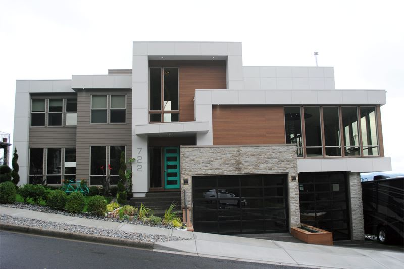 COURTESY: MA + DS MODERN HOME TOURS. - The front of Vito Tishenko's house in Camas. Built on a hairpin bend, it has commanding views of the gorge, and a half court on the back side.