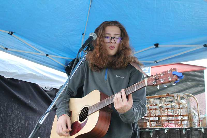 PIONEER PHOTO: CONNER WILLIAMS  - Timothy James, a freshman at Molalla High School, plays a few of his songs at the Molalla Farmer's Market on June 8, 2017. James will perform at the Waterfront Blues Festival in Portland on June 30 after earning a spot there from his performance at the International Blues Challenge in Memphis, Tennessee in January.