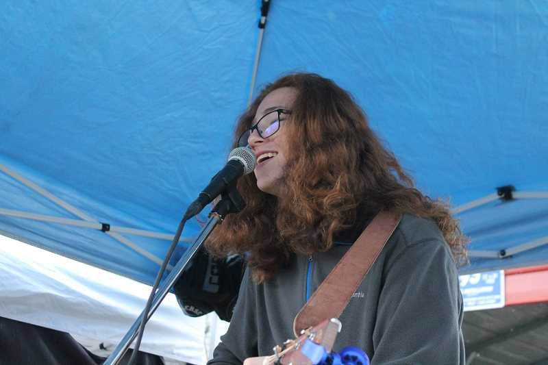 PIONEER PHOTO: CONNER WILLIAMS  - Timothy James plays a few of his songs at the Molalla Farmer's Market on June 8, 2017.