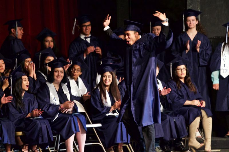 TIMES PHOTO: JAIME VALDEZ - Jorge Perez-Guerrero reacts after his name is announced during Merlo Station High School's graduation Saturdasy morning at Aloha High School.