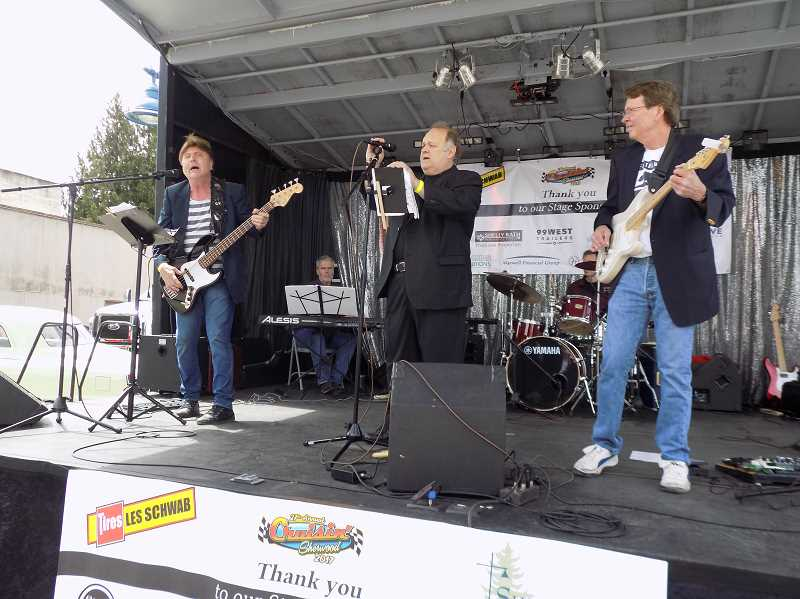 GAZETTE PHOTO: RAY PITZ - 99W, a group that covers classic rock tunes (and fronted by lead singer Scot Gavic, manager of the Sherwood Walmart), entertained crowds at Crusin' Sherwood on June 10.