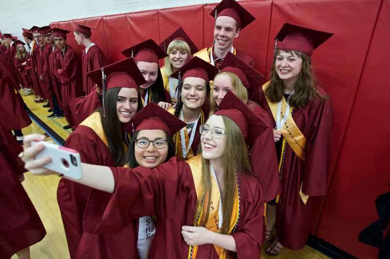 GAZETTE PHOTO: JAIME VALDEZ - Seniors take a selfie before Sherwood High School's graduation.