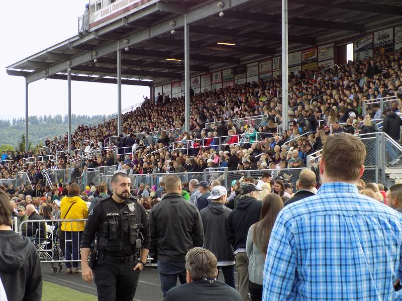 GAZETTE PHOTO: RAY PITZ - Huge crowd on hand to watch SHS graduation. Inspirational speaker, art teacher Raychell Rohrwasser, gives speech stressing tolerance.