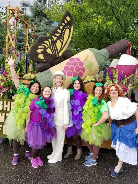 COURTESY OF LEAH BURGESS - Mayor Krisanna Clark, center, dressed in her Royal Rosarian finest, is joined by Leah Burgess, right of her and other costumed participants in this year's mini-float competition. Sherwood City Councilor Jennifer Kuiper, far right, played the part of Lucille Ball, recreating a classic 'I Love Lucy' episode involving the actress crushing grapes in a barrel.