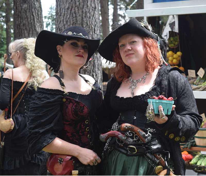 GIZELLE HADEED - A pair of comely wenches found something to enjoy Sunday at the Oregon Renaissance Faire.