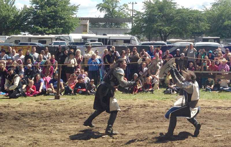 BRIAN STOREY - Knights joust during the tournament Sunday afternoon at the Oregon Renaissance Faire in Canby.