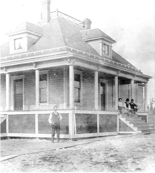PHOTO COURTESY: OAK LODGE HISTORY DETECTIVES - Philip Oatfield standing in front of his new house — as his bride, Dora Jane Thiessen, Michael Haberfellner and John Risley relax nearby.