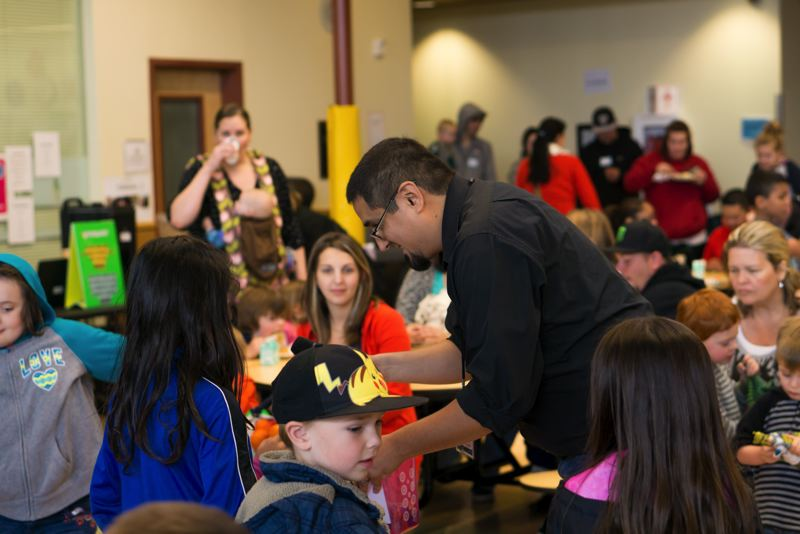 SUBMITTED PHOTO - Fernando Sobrevilla, ERSEA enrollment coordinator for the Clackamas County Children's Commission, interacts with attendees during Family Fun Day on May 20.