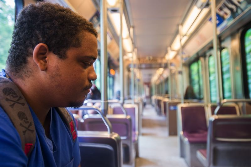 OUTLOOK PHOTO: JOSH KULLA - A.J. Stevenson rides the blue line MAX train to work daily, and says he won't be deterred from using public transit by the recent murders at the Hollywood Transit Center.