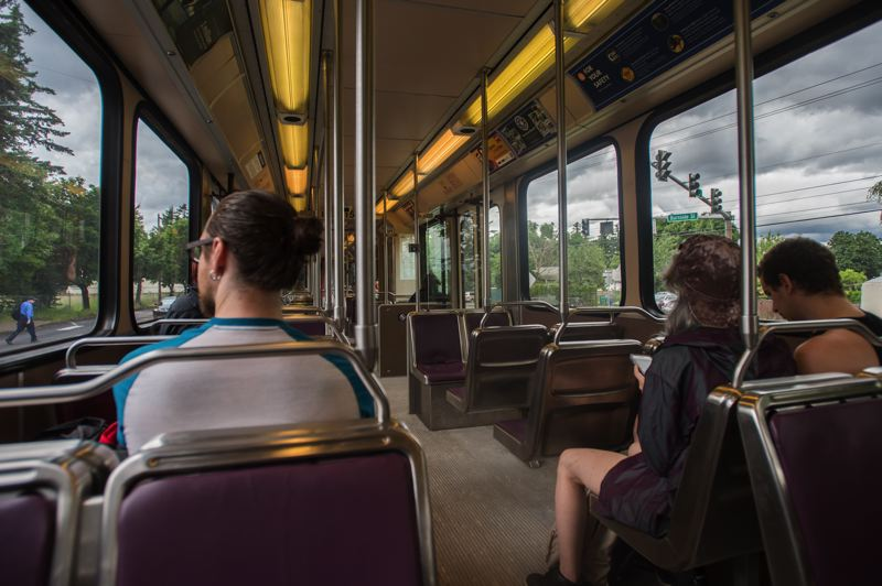 OUTLOOK PHOTO: JOSH KULLA - Trimet statistics show that riders like these on the Blue Line are unlikely to become a victim of crime — just one in 231,000 rides.