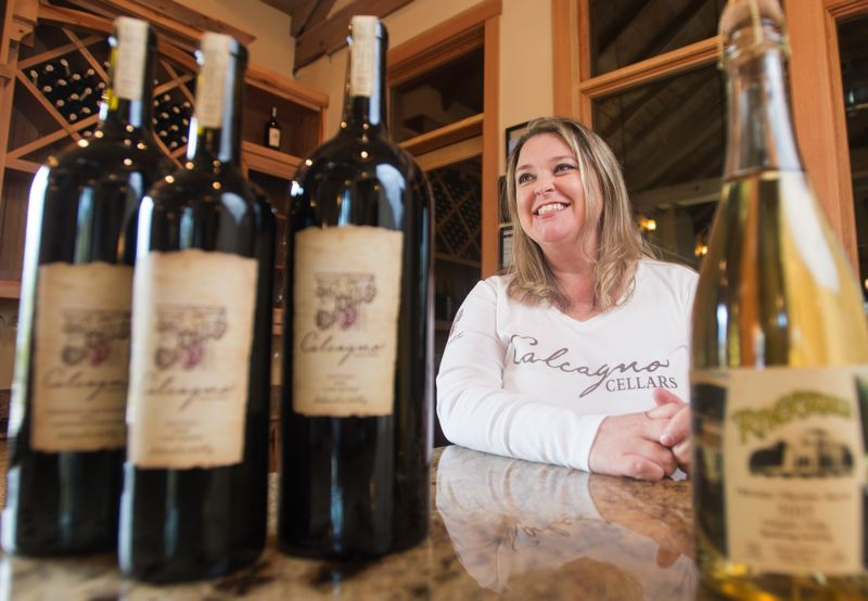 OUTLOOK PHOTO: JOSH KULLA - Kristi Calcagno and her husband, Frank, recently opened the Calcagno Cellars tasting room in downtown Troutdale. There, patrons may sample the award winning winemaker's various offerings in a newly refurbished room that is nearly a century old.