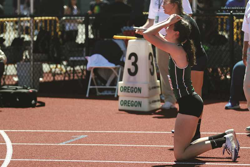 PHIL HAWKINS - North Marion sophomore Emily Scanlan celebrates after winning the state title in the 4A girls 100-meter hurdles competition at this year's state track meet in Eugene.