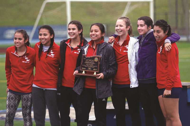 PHIL HAWKINS - The Kennedy girls cross country team celebrates its fourth-place finish at the 3A/2A/1A State Cross Country Championships in November.