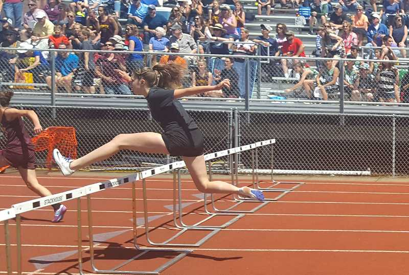 SUBMITTED PHOTO: LISA CORBETT - Molalla River Middle School eighth grader Kaityn Curry leaps over a hurdle during this year's Oregon Middle School Meet of Champions state meet last month.