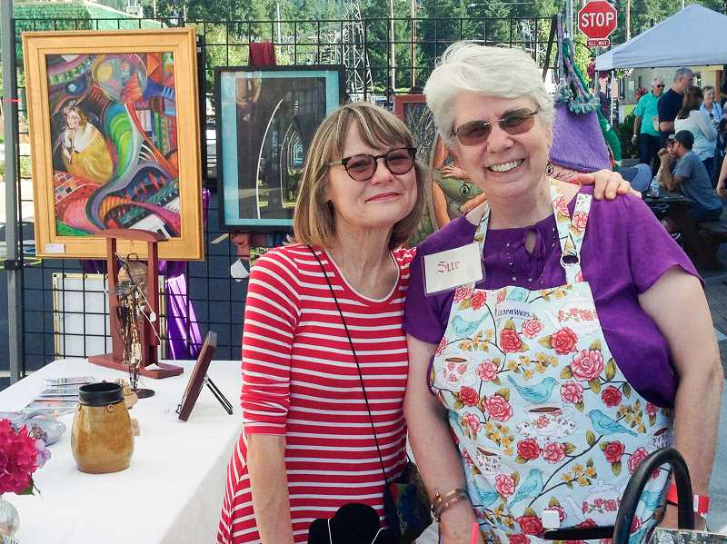 FILE PHOTO - Estacada Uncorked, a festival celebrating artisan food and drink with activities for children, is scheduled for Saturday, June 24. Here, Sue Dumolt and Nina Bradford smile at the Spiral Gallery's booth during last years event.