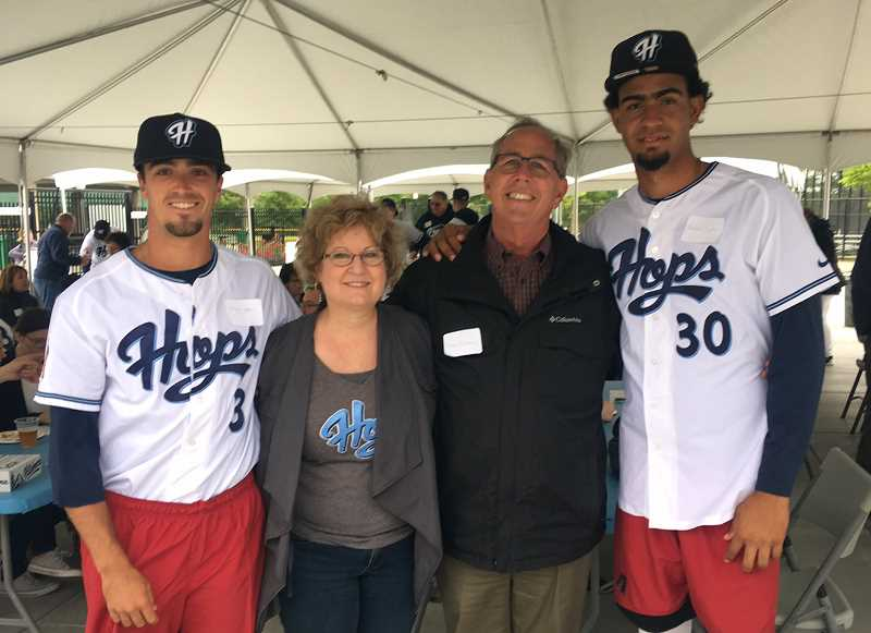 COURTESY PHOTO - From left: Mitchell Aker, Joan Callaway, Steve Callaway and Rafael Pujols at the meet-and-greet for Hops players and host families on June 12.