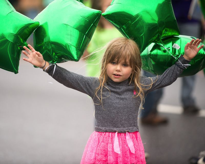 FILE PHOTO - A little girl enjoys the Kids Parade at last year's Sandy Mountain Festival.