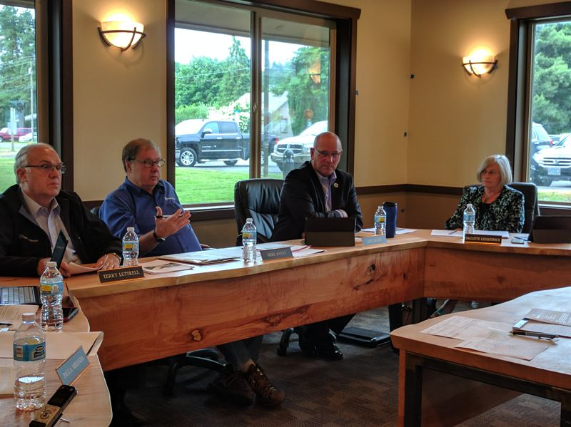 SPOTLIGHT PHOTO: COURTNEY VAUGHN - Port of St. Helens Commissioners discuss matters during a meeting Wednesday, June 15. Pictured left to right: Commissioners Terry Luttrell, Mike Avent, Larry Ericksen and Paulette Lichatowich.