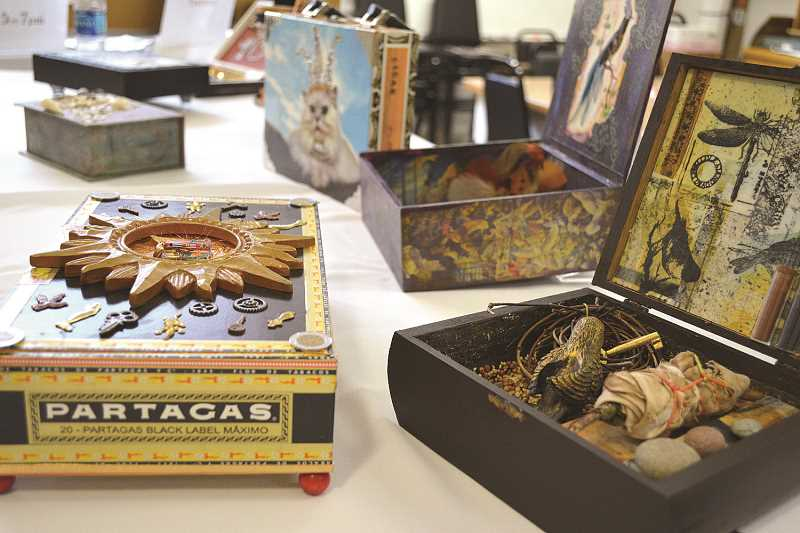 NEWS-TIMES/HILLSBORO TRIBUNE PHOTO: KATHY FULLER - Artists turned cigar boxes into Smokin Hot Art Boxes, which will be on display at Valley Art in Forest Grove on Saturday, June 17.