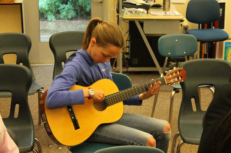 SPOKESMAN PHOTO: ANDREW KILSTROM - Ashlyn Ring plays an original song for her class Thursday, June 9 at Boones Ferry Primary.