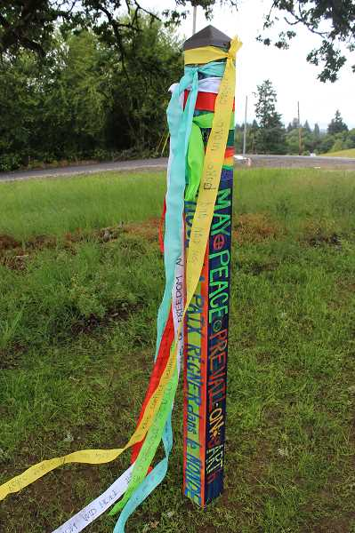 TIDINGS PHOTO: ANDREW KILSTROM - Donated by the West Linn Rotary Club, each grade level at Three Rivers brainstormed their own message of peace to tie to the peace pole.