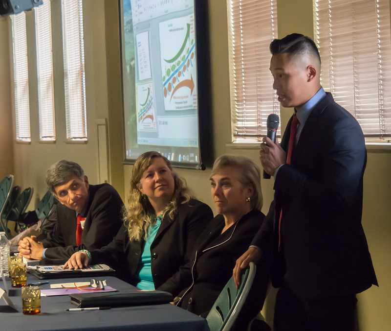PHOTO COURTESY OF REBECCA BENOIT/PIXELEGACY - Panelists Fariborz Pakseresht (from left), Christina McMahan and Deanne Darling listen to panelist Sang Dao recount his experiences in Oregon's juvenile justice system during a presentation last week at the Lakewood Center.