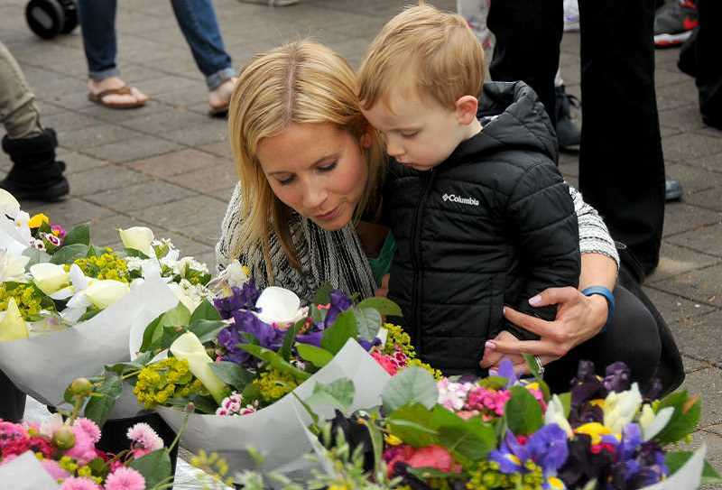 REVIEW FILE PHOTO:  - Amy Pritchard and her nephew, Fritz, check out bouquets of flowers on opening day at the Lake Oswego Farmers Market in 2015.